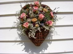 Victorian wall pocket vine heart filled with dried flowers, roses, and dried…