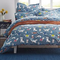 The dapper dogs on this duvet cover decked out in bowties, fedoras and berets, set against a soft blue ground.