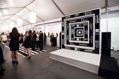 Instead of a red carpet, designers laid down a black-and-white-striped carpet at the entrance. Photo: Roderick Peña