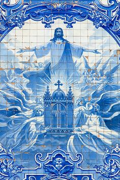 Blue tiled artwork of Christ on a street in Porto, Portugal