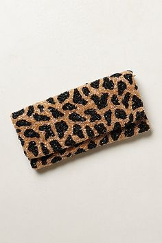 This clutch has serious style. For the girl that thinks leopard is a neutral.