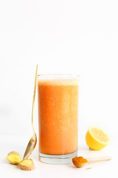 7-ingredient smoothie with fresh carrot juice, ginger, turmeric, pineapple and banana! Almond milk adds a creamy texture to this immune-boosting, anti-inflammatory beverage.