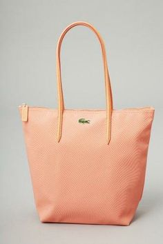 Jayma Mays: Lacoste L.12.12 Concept Medium Vertical Tote in Fusion Coral | $98