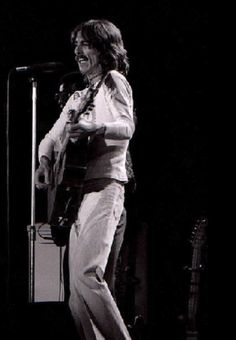 George Harrison performs at The Omni in Atlanta, Georgia during the Dark Horse Tour  11/28/1974 source : Flickr