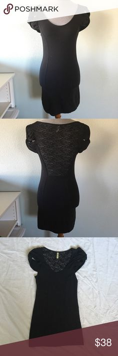 Free People Black Bodycon Dress free people black bodycon dress / tunic. gorgeous lace back and caged sleeves. the details really makes this little black dress special! will show off your figure! in like new condition. looks weird on the mannequin since it doesn't have legs. my mannequin's measurements are 34-26-35. 10% off bundles of 2 items and 15% off bundles of 3+ items. Free People Dresses Mini