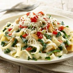 Creamy Chicken Pasta Florentine Recipe Main Dishes with Knorr® Pasta Sides™ - Butter & Herb, cream cheese, soften, spinach leaves, cut up cooked chicken, shredded mozzarella cheese, tomatoes