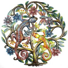 This piece of Haitian metal wall art is 24 inches in diameter. It features a tree of life with geckos, hand-cut, embossed and painted.