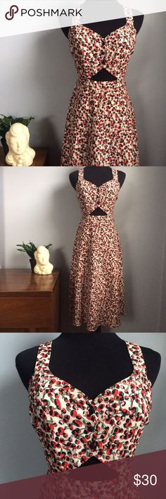 Vintage Retro Inspired Floral Midi Dress Gorgeous! In great condition. Worn once. No visible signs of damage. Has a cutout blow the bust, with a low back and cross cross straps. Great for a 1940s-1950s pin-up girl look. Forever 21 Dresses Midi