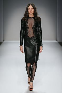 This leather dress is completely backless except for a sheer floral lace panel