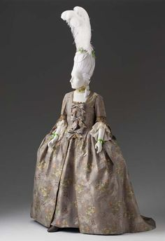 Robe a la Française (open gown with visible petticoat), England, 1745-1750. Pale brown silk brocade with floral motifs in silver thread and coloured silk.