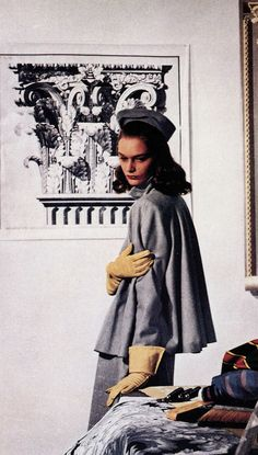 1947 Sandra Payson in suit by Roxspun, hat by Sally Victor, photo by Louise Dahl-Wolfe, Harper's Bazaar,