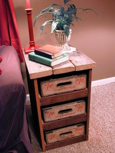 End table made with salvaged wood and with old wooden 7up soda pop crates for drawers.