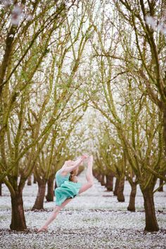 Leaping through the almond orchard.  I love spring! Dance pictures