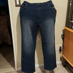Quacker Factory rhinestone edged jeans Cotton spandex blend 5 pocket jeans with elastic at the back of the waist belt loops. Jeans have side seams and pockets in the front lined with Aurora Borealis rhinestones. The pictures don't do the rhinestones Justice. Inseam 29 inches. Brand new with tags and never worn. Quacker Factory Pants Straight Leg
