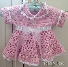 Crochet Baby Dress free pattern by Red heart                                                                                                                                                                                 More