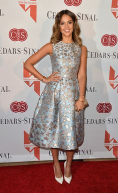 Jessica Alba wears a shimmery printed Mary Katrantzou midi at the Helping Hand of Los Angeles Mother's Day Luncheon.