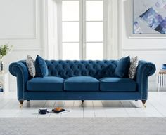 The Carrara Blue Velvet 2 Seater Sofa features a chic design and colour to enhance any living area. Upholstered in blue velvet and featuring a deep-buttoned design with scrolled armrests, the 2 seater sofa is complete with 2 free cushions. Velvet Furniture, Sofa Furniture, Sofa Chair, Chaise Sofa, Chesterfield Sofa, Furniture Market, Sofa Price, Best Leather Sofa, Chairs