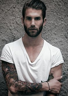 Perfect hair, manicured beard, white v neck tee, tattoo sleeve, and a string bracelet. What more could a guy ask for?