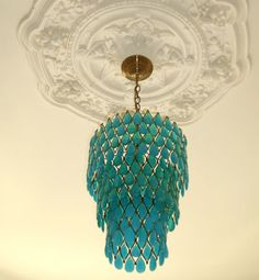 turquoise emerald chandelier on a white ceiling with plasterwork