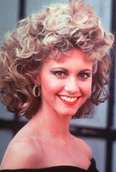 Olivia Newton John.  Love the hair.