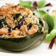 Acorn squash's natural shape makes it just right for stuffing. This filling has Mediterranean flair: olives, tomato paste, white beans and Parmesan cheese. Serve with: Mixed green salad with radicchio and red onion and crisp white wine, such as Pinot Grigio.