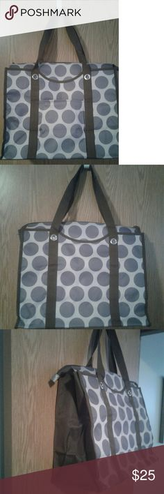Thirty-One All-Day Organizing Tote Grey Mod Dot Great bag can be used for multiple things. Dots are grey, the background is a lighter grey and the trim is dark brown. Has a zippered top, one outside pocket, two handles can be worn on the shoulder. Inside has two mesh pockets on each end and there is also two pockets on the side one zips thirty one Bags Totes