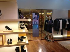 1x2 ORION Portrait Orientation Videowall behind etched mirror glass. Installation by KRITON Electronics Inc.