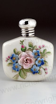 VINTAGE 1920 PORCELAIN SCENT PERFUME BOTTLE WITH RELIEF FLOWER DECORATION, SILVER TOP. This item is sold, to visit my website to see what's in stock click here: http://www.richardhoppe.co.uk or for help or information email us here: info@richardhoppe.co.uk