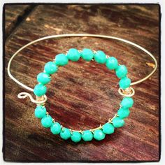 Gold and Vermeil bangle bracelet with wire-wrapped turquoise glass beads. $42.00, via Etsy.