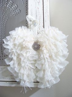 Beautiful angel wings - perfect for your wedding, bridal or baby shower, nursery decor, Christmas, house warming gift or for someone that adores shabby white shabby cottage style home decor... Beautiful for any occasion! Full of great texture lots of ruffles made from sheer ivory organza fabric. Embellished with scrunched seam binding, eyelash yarn and a large rhinestone cabochon. Frayed edges are intentional and add to the charm. Rhinestone accent will be the same as pictured. If you would…
