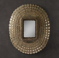 obsessing over this peacock mirror. It's the same one seen at the Parker in Palm Springs inside their lobby