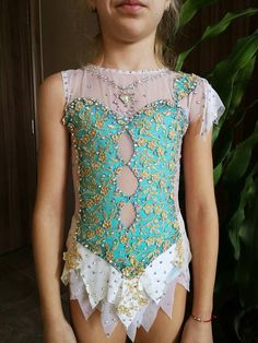 As all leotards are handmade, each is unique and thus there might be minor differences from the one shown on the photo. The difference could occur because the size you order could be different, the colors might slightly defer depending on the colors of your screen and the decoration might