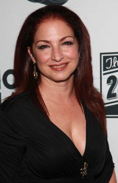 "Singer-songwriter, actress and humanitarian Gloria Estefan was bringing the rhythms of Latin America to the masses long before the ""Latin Explosion"" of the late '90s, establishing herself as one of the hardest working women in the entertainment industry—and a much-needed beauty icon for young women of color. The Miami-based mother-of-two has said, ""A woman's exterior beauty is a reflection of her internal peace and happiness."""