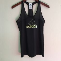 """Adidas workout tank Like new! Black with gold foil """"adidas"""" on front. Has mesh on straps and top part of chest. Adidas Tops Tank Tops"""