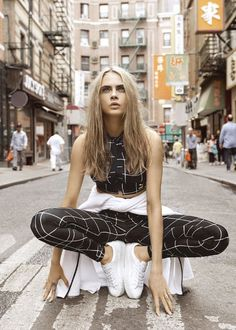 Cara Delevingne New York Street Style Black Matching Athletic Sportswear Two Piece With White Aztec Zig Zag Line Pattern Detail Top And Pants
