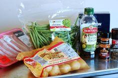 Easy sheet pan dinner with boneless pork chops, potatoes and green beans.