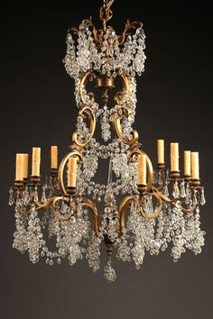 Late 19th century antique French 12 arm bronze and crystal chandelier with clumps of crystal grapes. circa 1890. #antique #chandelier #bronze #crystal