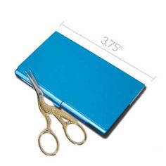 "This metal scissors case is perfect for your small embroidery scissors.  There is a magnet on the bottom to hold needles, threaders, and other tools.  3.75"" x 2.25"" x .25"".  Assorted colors. #stitching #embroidery #needlework"