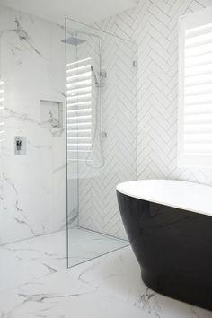 A black bath is a beautiful addition to any white bathroom. The contrasting colours creates a bold and satisfying design. #blackbath #freestandingbath #whitebathroom