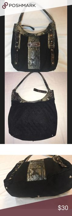 "Women's GUESS big Purse with Snake skin print Authentic Gorgeous Women's Guess Logo Large Black/Gray/ Snake print leather Deep Pocket Hobo Shoulder Bucket Bag in excellent condition. With a Guess logo across the front middle of the bag. Measurements are approx. 13"" H x 14"" W (length across strap edge) with a strap drop of 12"". Large bucket bag with multiple inside pockets for accessories. Bag is in excellent condition with no marks and scratches from use. No rips or stains and smoke free…"