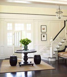 Beautiful entry-dark floors, lots of light, wonderful moldings -so pretty!