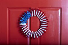 Clothespin Wreath - Festive 4th of July Wreaths for Your Front Door - Southernliving. Break out all of those extra clothespins and put them to good use. Paint clothespins red, white, and blue. Add silver star stickers to the blue ones, and clip the clothespoins at alternating positions on a wire wreath form. Alternate red and white around the wreath, and cluster the blue at the top left of the wreath. You can also track down red, white, and blue clothespins at the store to avoid the painting…