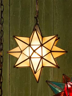 The translucent white glass of this pendant diffuses the light for a subdued glow that recalls the Moravian star's paper origins. From @zincdoor