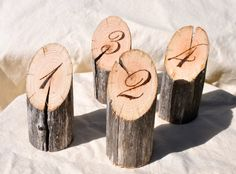 Weather worn eucalyptus wood branches with numbers burned into the freshly cut wood. These will add a subtle touch of nature to your cafe setting, wedding or event.  These table numbers stand about 10 cm (4 inches) tall with a basal diametre of around 4 cm (1.5 inches) or so.  This listing is for twenty table numbers. Numbers 1 - 20.  There will be some natural variation in colour, and width and cracking in the table numbers. I will not sell anything that I would not happily display myself…