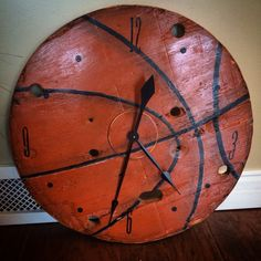 """Basketball clock made from wire spool end. 24"""", mechanisms available at Hobby Lobby."""