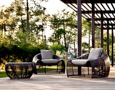 CROISSANT LOUNGE ARMCHAIR (OUTDOOR VERSION)  Materials: Polyethylene fiber, nylon, steel Dimensions: 41W x 38D x 27H (17 seat height)  Options: Indoor (Abaca), outdoor, natural or brown