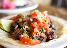 Slow-Cooker Flank Steak Tacos - Flank steak is a leaner cut of red meat. You can also top these tasty tacos with avocado and cheese if desired.