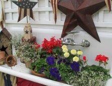Recycle stuff into garden art.