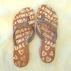 Coach Sandals NEVER WORN! These are super cute silver Coach sandals! They are apart of Coach's Poppy Collection! They have a flat heel. Coach Shoes Sandals