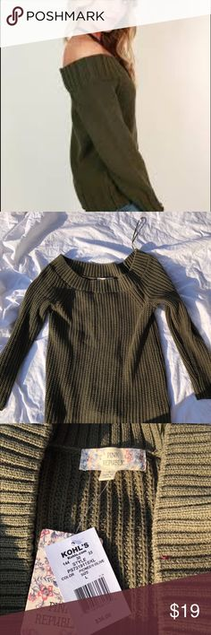 NWT green off the shoulder sweater in size large NWT green off the shoulder sweater in size large. Please look at the second photo. The sweater I am selling is not identical to the cover photo but it is used as an example. Sweaters